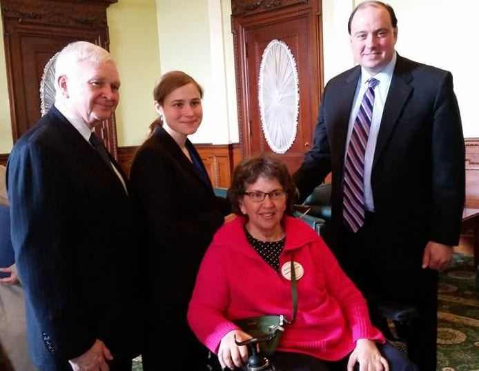 Four people pose at the AHVP Briefing at the State House