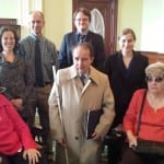 A group of seven BCIL staffers and members at the Massachusetts State House