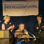 Person in wheelchair speaks to audience.