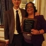 A staff member of BCIL poses with an honoree award winner.