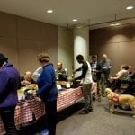 Attendees help themselves to a catered dinner.