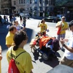 People standing in a group wearing yellow ADA 25 t-shirts.