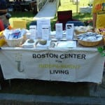 The BCIL information table along with buttons, candy, pens and stickers.