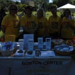 BCIL staff take a group photo at their information table.