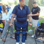 A person on crutches looks to his left.