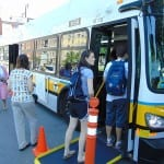 People boarding an MBTA bus.