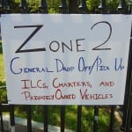 "Sign reads ""Zone 2 General Drop Off/Pick Up, ILCs, Charters, and Privately Owned Vehicles."""