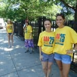 People in yellow ADA 25 t-shirts smile for a photo.