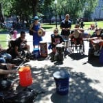 Group of people in wheelchairs play musical instruments.