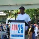A person addresses the crowd at the ADA 25 event.