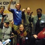 2015 Comm Service Awards winners hold fists in the air.