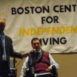 Speaker in wheelchair addresses the audience