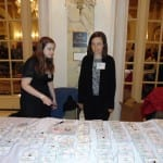 Two BCIL staff members organize guest name tags.