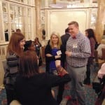 Guests engage in conversation over refreshments.