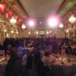 Attendees talk among themselves while seated in the ballroom.