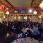 Attendees seated in the ballroom.