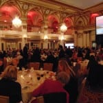 Attendees seated in the ballroom
