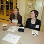 Two BCIL staff members at the registration table.