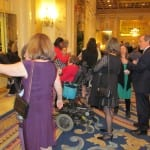 Attendees talk in the lobby.