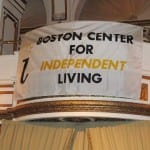 Boston Center for Independent Living banner suspended from a balcony.