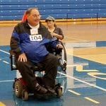 People in wheelchairs doing laps.