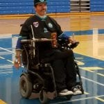 A person does laps for the fun run in their wheelchair.