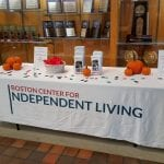 BCIL table with brochures, wristbands and decorative pumpkins.