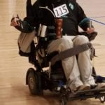 A person in a wheelchair participates in the run.
