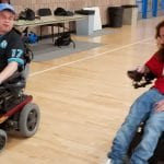 Two people using wheelchairs participate in the run.