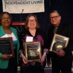 2019 honorees standing holding their awards.