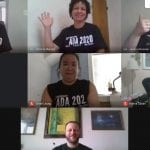 A group of people meet up over Zoom, each one wearing a black ADA 2020 t-shirt.